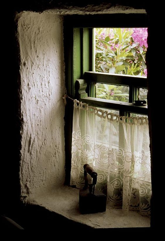 Ireland cottage window with antique iron