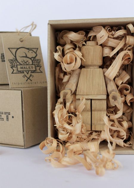 Wooden LEGO figures by Malet Thibaut. I love how they're packed in shavings.