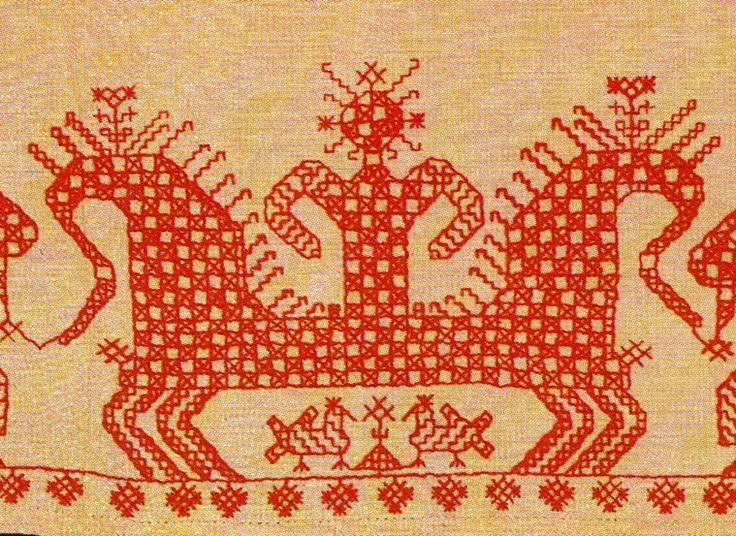 Europe - Russia/Archangel region, hemline of a woman's underdress. The Maiden crowned with the Sun drives a chariot.   Two horses are harnessed into it.   A checkered pattern covering the picture symbolizes characters depicted are gods. There are birds under a horse's belly: it means the chariot flies in the sky.
