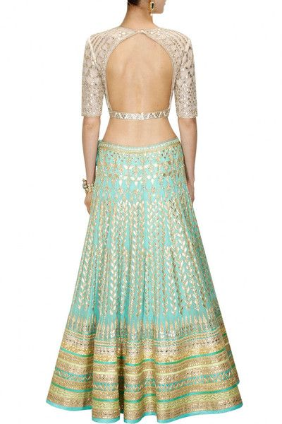 This Aqua color Bridal Lehenga Choli is featuring in georgette fabric embellished with traditional gota patti embroidery. This Aqua color Bridal Lehenga Choli i