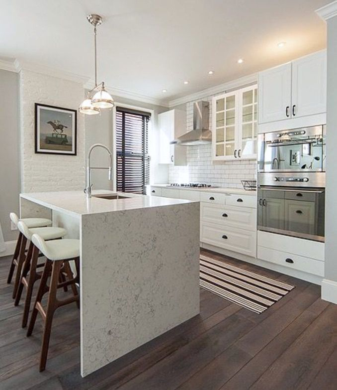 white cabinets + waterfall counter