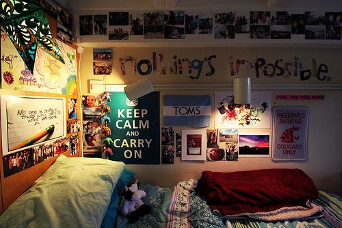 "Dorm room- filled with quotes, phrases and pictures. ""Nothing's impossible"" (magazine lettering);""Keep Calm and Carry On""(picture) and TOMS(flag)."