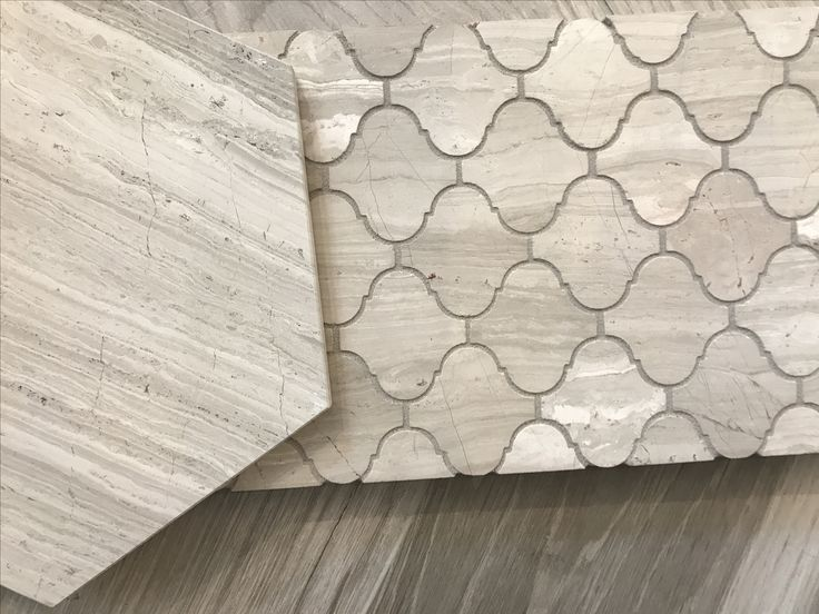 Different option for flooring (Ann Sacks).  Prefer the hive design as this is very New York traditional design.