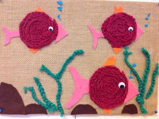 Sormivirkkauksella tehtyjä kaloja ja vesikasvillisuutta.