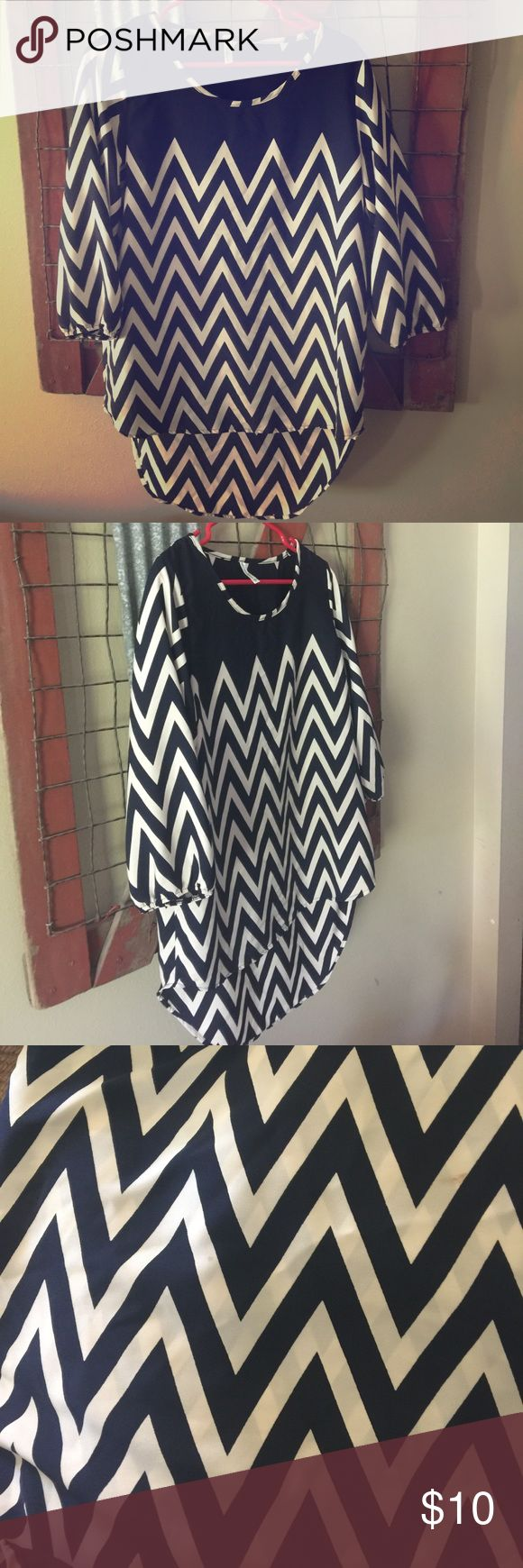 Chevron blouse, navy and white. M/L Boutique navy and white chevron blouse. Longer in the back, very flattering loose fit! 2 very small blemishes, see pic for example Tops Blouses