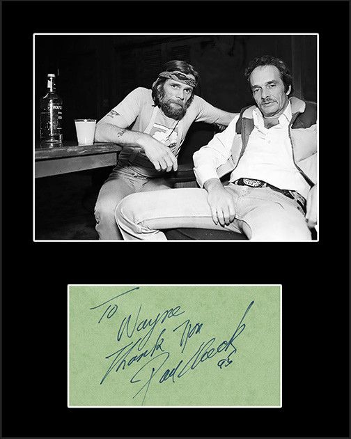 Country Music Star Johnny Paycheck Framed Matted Signed Autograph and Photo, sharing some vodka with Merl Haggard. Comes with certificate of authenticity. Johnny was a country music singer and Grand O