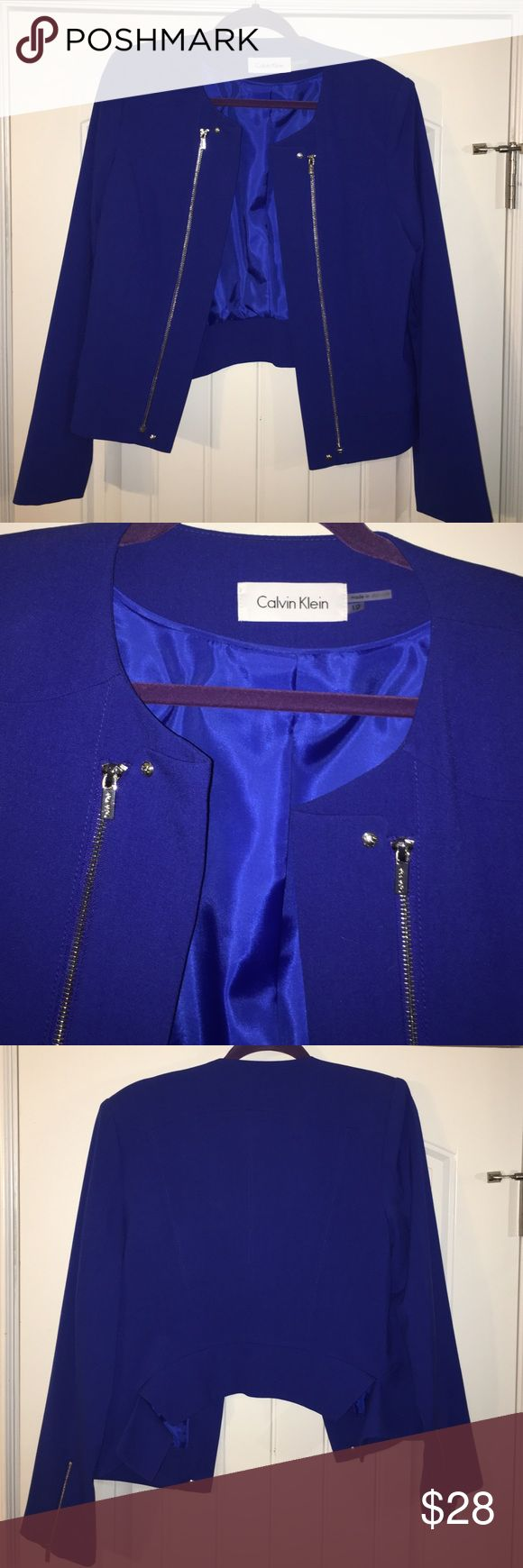 NWOT Calvin Klein Royal Blue Blazer Jacket sz 12/L NWOT Calvin Klein Royal Blue Blazer Jacket sz 12/L. Never worn or used. Beautiful blue with silver Zip accent in front and at wrist. Bundle and save!! Calvin Klein Jackets & Coats Blazers