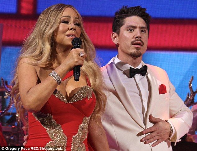 Christmas concerts: Mariah Carey performed alongside boyfriend Bryan Tanaka and her twins Monroe and Moroccan on Tuesday in New York City