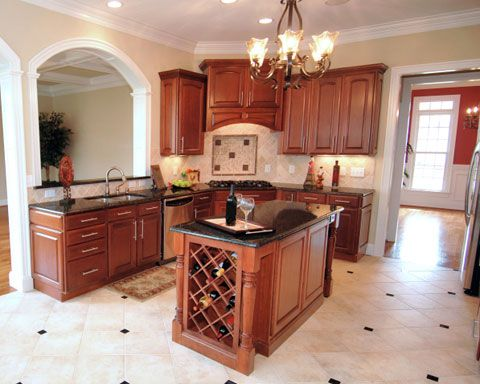 The layout of this traditional style kitchen perfectly - Kitchen center island ideas ...
