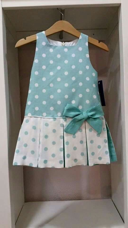 Contrasting inset pleats with piping and a single bow