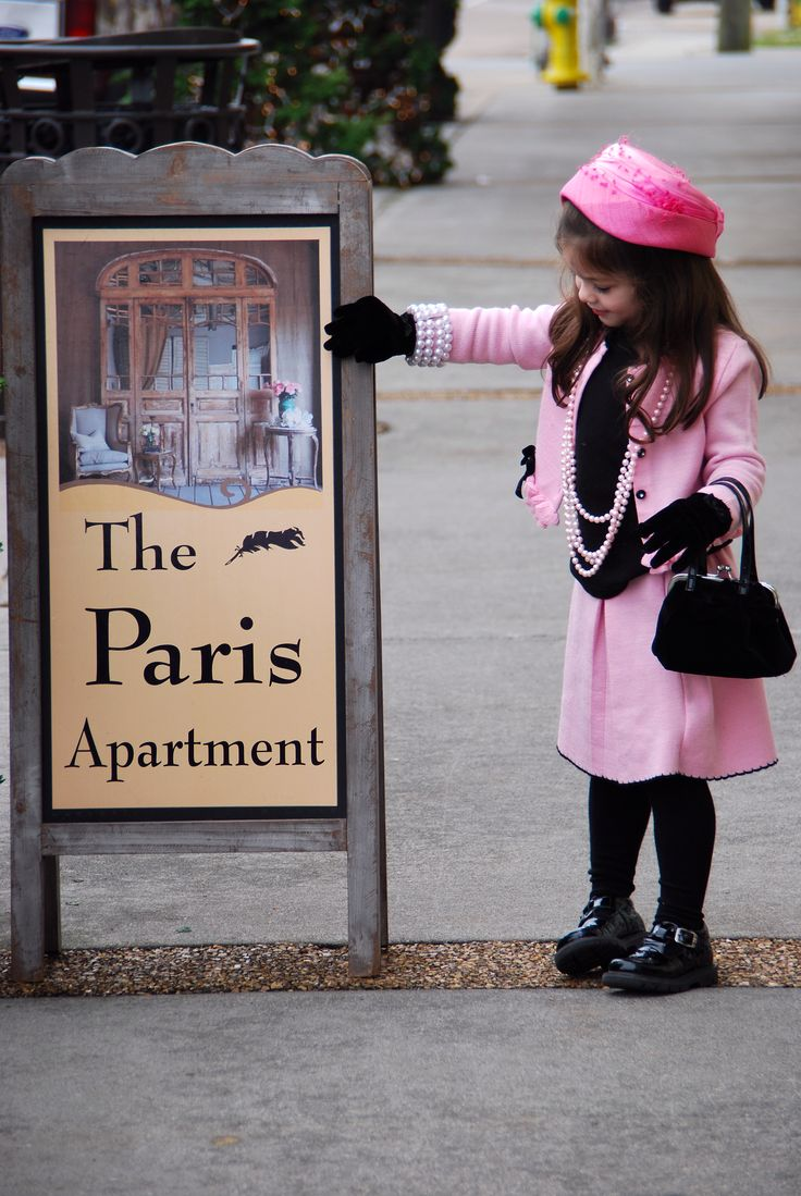 Little girl after having tea at The Paris Apartment in Sweetwater, TN  I prefer the beautiful innocent party dresses now available for girls...this little one looks like a miniature Jackie Kennedy Onassis in the pillbox hat.
