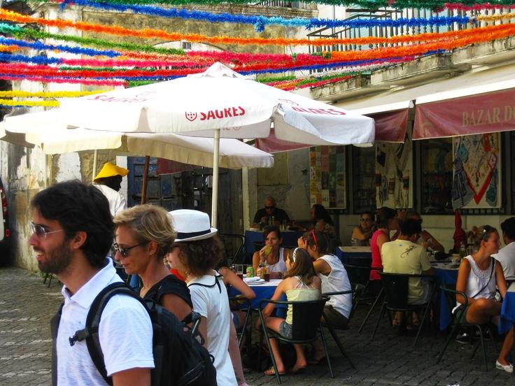 """FESTAS TRADICIONAIS - S. António celebra- se a 13 de junho. As marchas descem a avenida e nos bairros típicos de Alfama, Mouraria, Castelo... as pessoas comem sardinha, dançam e compram os manjericos. """"St. António"""" is celebrated on June 13. The popular marches go down the avenue and in the typical neighbourhoods of Alfama, Mouraria, Castle ... people eat grilled sardines, dance to the sound of popular music and buy """"manjerico"""" with fortune sayings. It's a five senses' journey. - PORTUGAL…"""