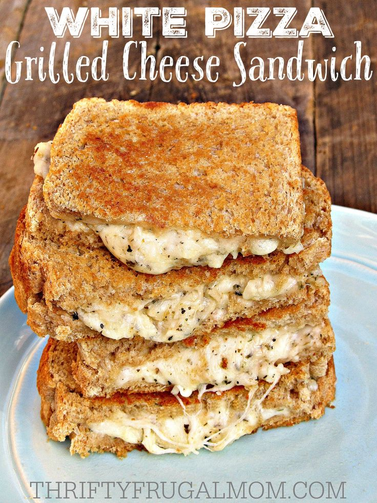 White Pizza Grilled Cheese Sandwiches- The best grilled cheese sandwich recipe ever!! Loaded with 3 different cheeses, garlic and herbs, it's the perfect comfort food.