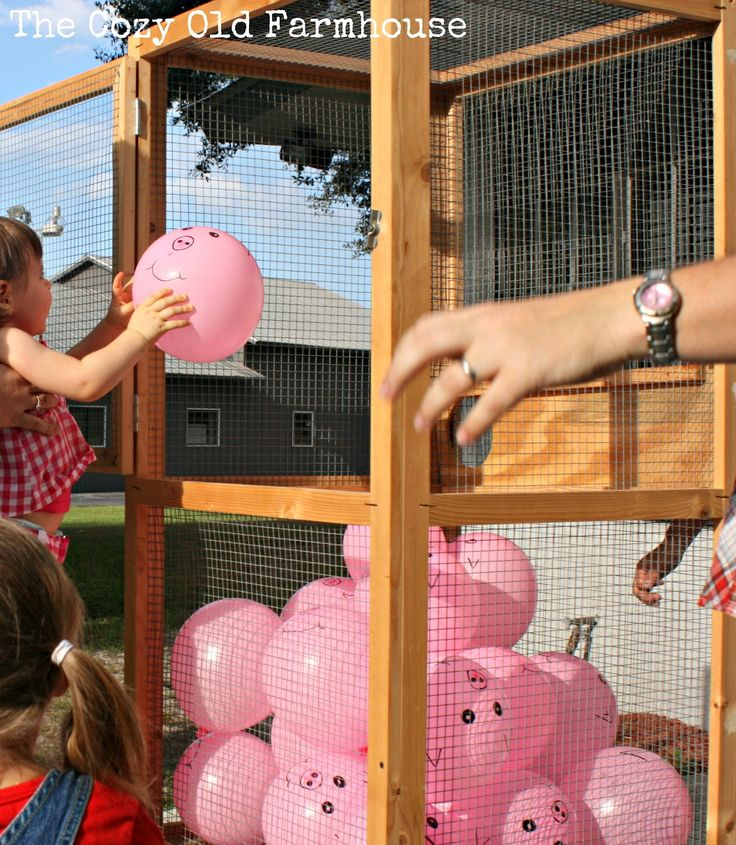 "farm party game ideas - I love the pig game!  We also did a fun little game outside called, ""The Pigs are Loose!""  I blew up a bunch of little pink balloons and drew pig faces on them.  We then placed them in a container (my in-laws had a squirrel cage that worked out perfectly)"