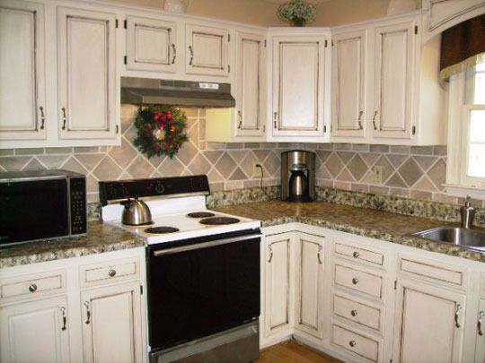 """DIY rental kitchen makeover for $17! Love the """"tile"""" back splash! Painted counters too!"""