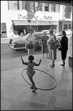 A Hula-Hooping girl. Columbia, South Carolina, 1958 | photo by Constantine Manos