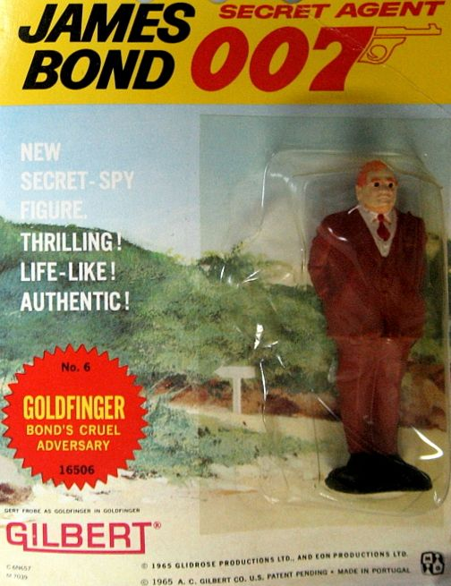 "Original 1965 James Bond ""Goldfinger"" Action Figure, by Gilbert. From the great James Bond 007 craze of the '60's comes this AUTHENTIC 1965 figure of ""Goldfinger"", 007's arch-enemy, whose golden touch is...DEADLY! MINT ON SEALED CARD!! These Gilbert action figures and some of the toys and playsets they came out with in the same time period were among the FIRST OFFICIALLY-LICENSED JAMES BOND TOYS! Only one in stock. $75.00"