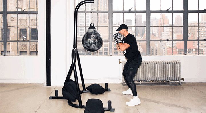 Rumble's Co-Founder Shares a Boxing Workout for Your Butt: Boxing is more than punching and ducking (and imagining your ex's face on a bag). It can also be one hell of a lower-body workout. Don't believe us? Just try the 10 butt-lifting combos that Noah Neiman, the trainer and co-founder of Rumble (NYC's newest, you guessed it, boxing studio), created just for us.—How to do jump squats. | coveteur.com