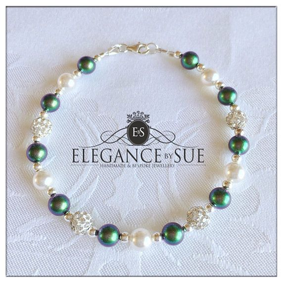This gorgeous bracelet was a customer request and was made using Swarovski Elements scarabaeus green and white pearls, clear crystal shamballa beads, sterling silver beads and clasp. Bracelet measures just over 18cm (7 inches)  These stunning Swarovski Elements are from glass pearls in crystal scarabaeus are one of the new colours from the Fall/Winter 2016/2017 innovations range, which is in collaboration with Jean Paul Gualtier. Inspired by the roof of the Paris opera house - these...
