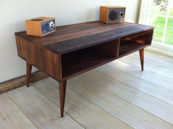 Mid century modern TV table/entertainment console, black walnut with tapered wood legs. $675 on Etsy