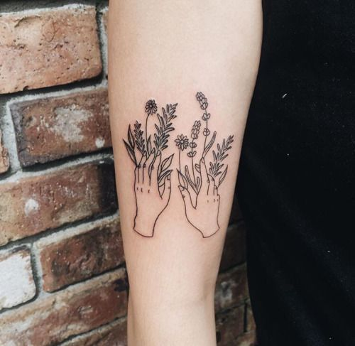 """<p>We love this simple illustration tattoo of two hands picking flowers. Just look at the detail! <i><a href=""""https://uk.pinterest.com/pin/426575395935046874/"""">[Photo: Pinterest]</a></i><br /></p>"""