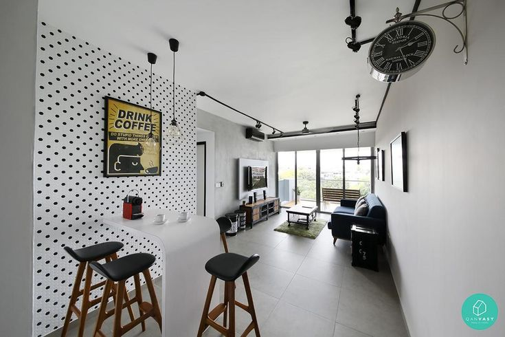 Quirky clocks, polka dot walls and hipster posters. What is not to love about this living room? #polkadotwalls #displayclock #industrialtheme