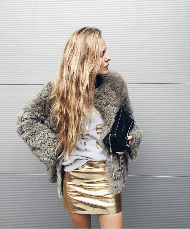 @mvb412 rocking 70s vibes in our ANINE BING sweatshirt with gold print and classic leather metallic skirt ❥ www.aninebing.com #aninebing #aninebinggirls