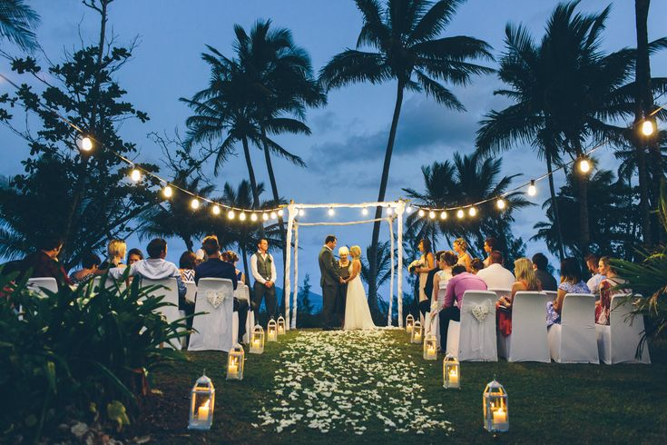 Looking for a magical dusk ceremony?! The luscious gardens of Castaways Resort & Spa in Mission Beach boast tropical palm trees and gorgeous clear skies. Such an intimate wedding!
