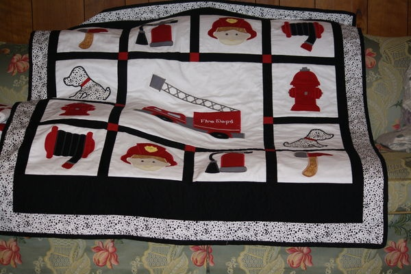 too bad they didn't have a better shot of this one, but it is a great layout for a fireman quilt!
