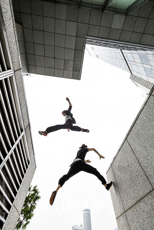 parkour in the city of singapore two guys jumping across ventilator
