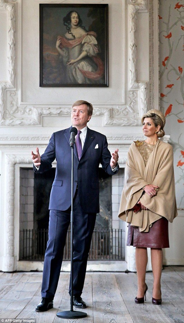 King Willem-Alexander of the Netherlands speaks next to Queen Maxima of the Netherlands...