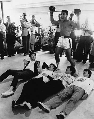 Muhammad Ali poses with the Beatles in 1964.
