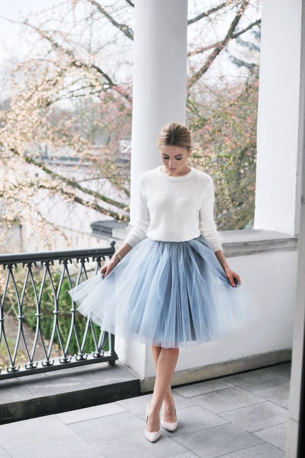 Adorable white sweater with a delicate blue tulle skirt. Would look great on a guest at a winter wedding!