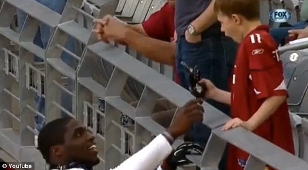Jaw-dropping token: Arizona Cardinals linebacker Sam Acho made one little boy's day after he not only paused to chat with the fan on the sidelines but reached up to give him one of his gloves