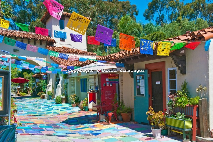 Spanish Village, Balboa Park, San Diego, CA by David Zanzinger.  Love the bright bunting =)