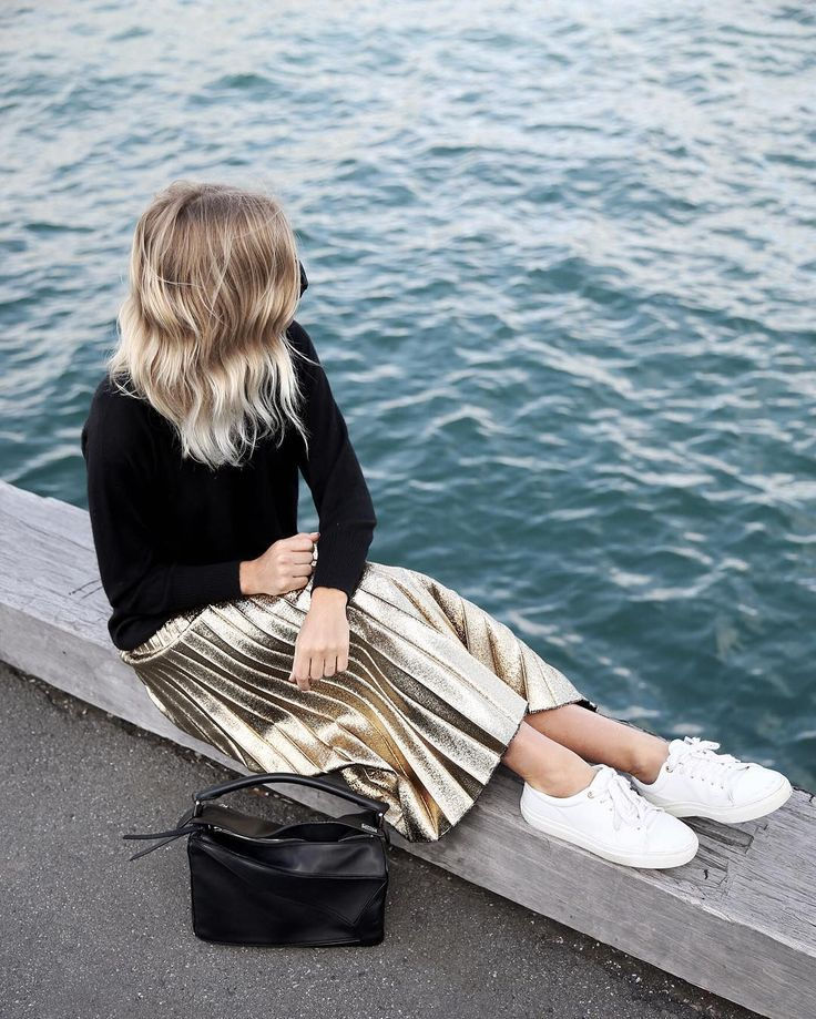 Black sweater, gold pleated skirt & white sneakers @wethepeoplestyle