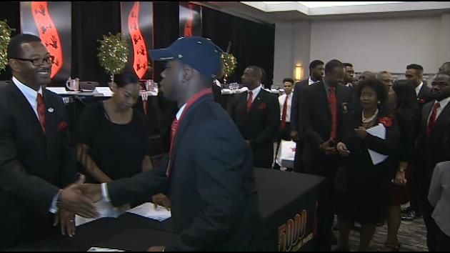 Almost a hundred Miami-Dade high school seniors received scholarships for college, thanks to a special program.