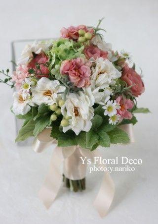 昨日愛知にて挙式ご披露宴の新婦さんのためお作りさせていただいたクラッチブーケ&花冠です。白にピンクをいれてます。アーティフィシャルフラワーでお作りしていま...