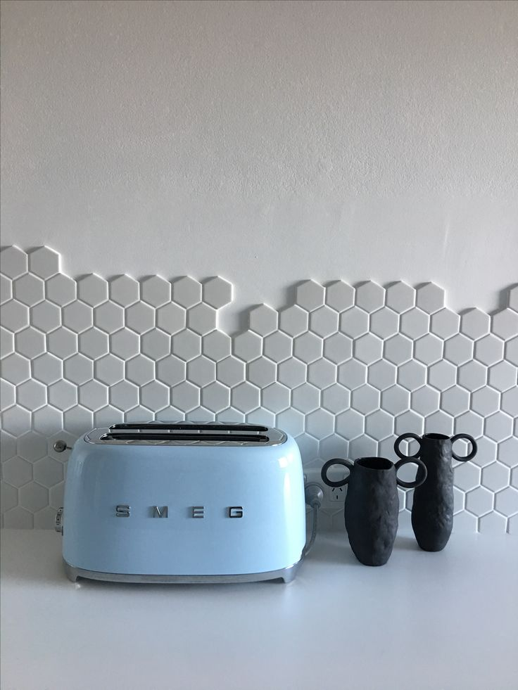 White hexagon tiles. Kitchen splashback