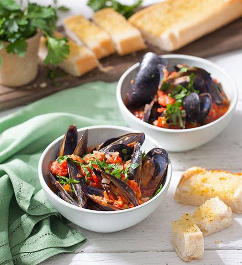 Steamed mussels with garlic bread: Mussel in on the action with this classic seafood supper. And don't forget the garlic bread! It's totally essential for mopping up the juices.