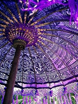 ...Purple stained glass windows create an amazing ceiling with the sun shining through...