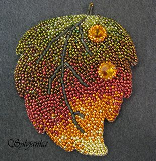 "I think this is beaded but I can see it done as a ""mosaic"" in mung beans, adzuki beans, lentils and wheat or rice grains..."