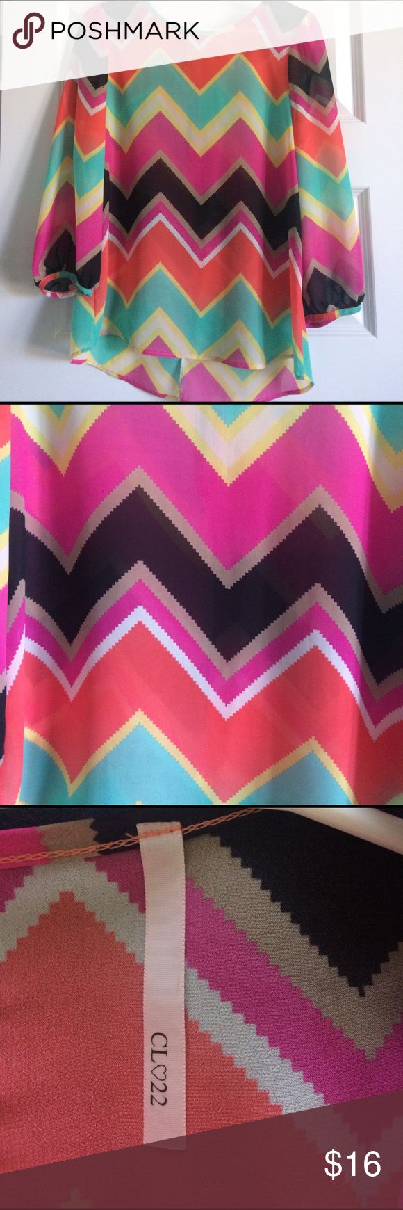 Boutique chevron blouse Gorgeous chevron blouse. Never worn. Size L (would fit a 8-12 in my opinion) Tops Blouses