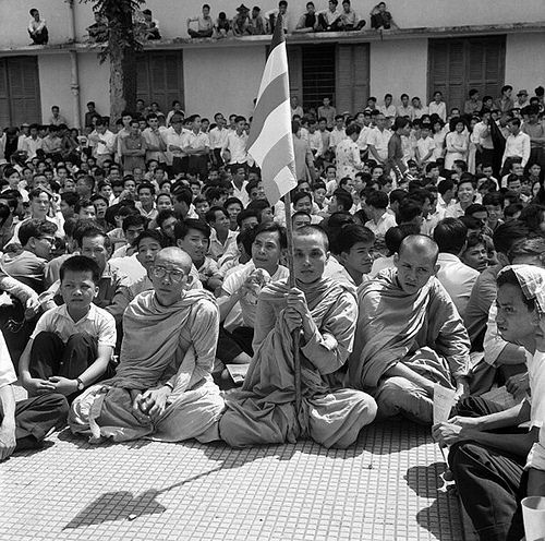 Crowds gather at Xá Lợi Pagoda on a third day of mass protests against the administration of South Vietnamese President Ngô Đình Diệm, with crowds topping 15,000, Saigon, South Vietnam, 1963, photograph by J. M. Burfin. Raids by special forces troops that night, under the orders of President Diệm's brother Ngô Đình Nhu, would mark a turning point in American support for the regime, with US policy officially abandoning Nhu and his wife and leading to the eventual coup against Diệm's…
