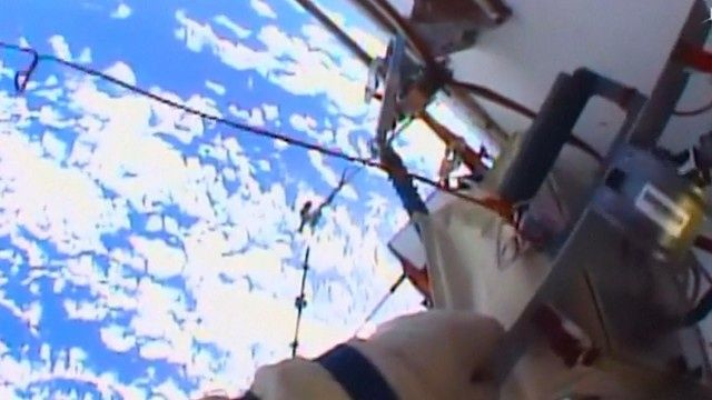 Russian astronauts go on spacewalk to clean windows and upgrade station   Science   The Guardian