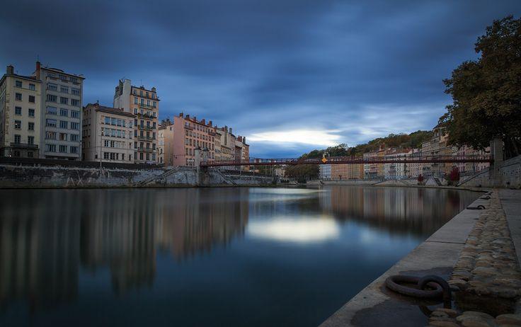 Dark Lyon - Dark clouds above the Saone river and Passerelle Saint-Vincent in Vieux Lyon at dusk.