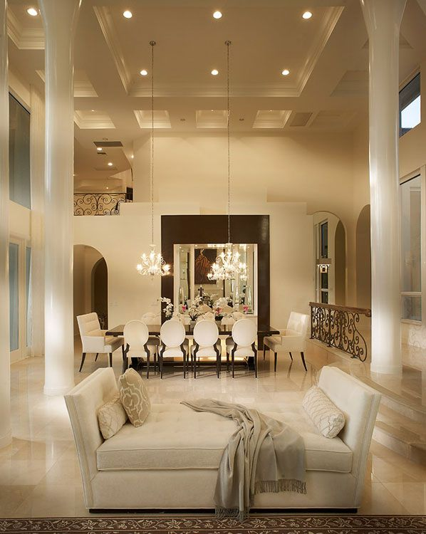 Just stunning! Love this living room and dining room space - beautiful lighting.