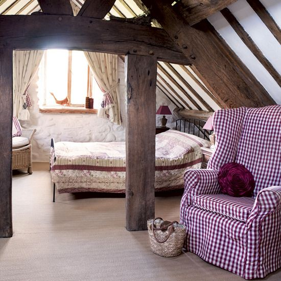 Use beams in attic as doorways or room dividers. Maybe add curtains on either side of the walking area to visually divide the rooms