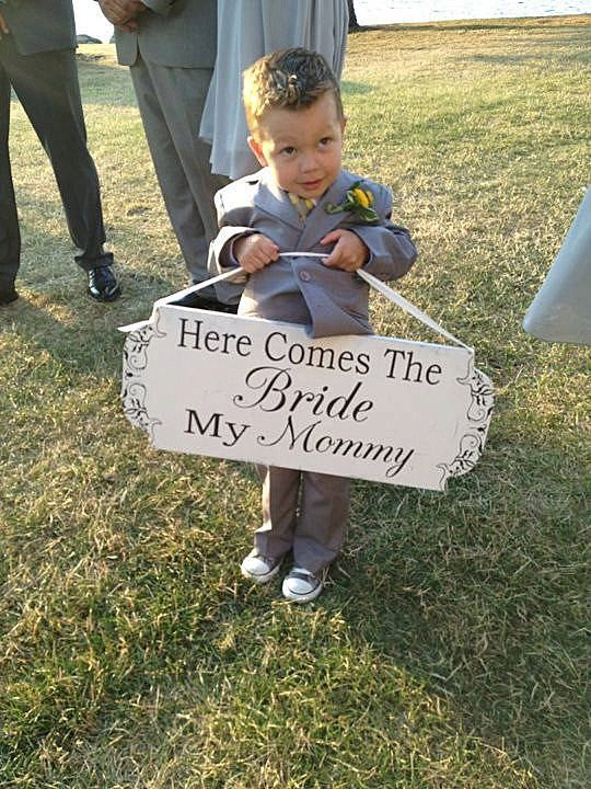 Would love Ella to carry something down the isle like this that reads; Daddy, here comes Mommy.