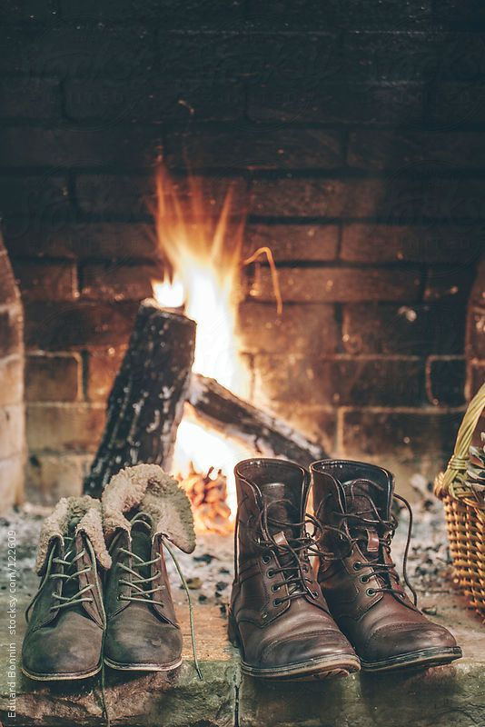 Shoes drying at the fire after a long day in the snow